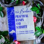 book of Hanon exercises with roses and gray linen