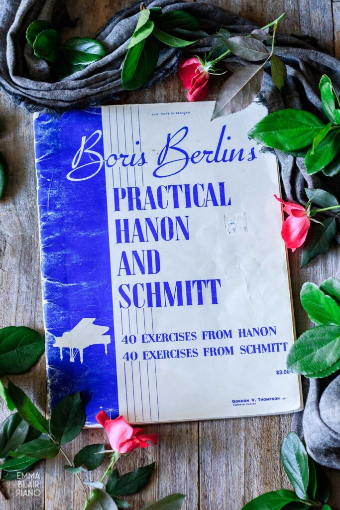 book of Hanon exercises with roses and greenery