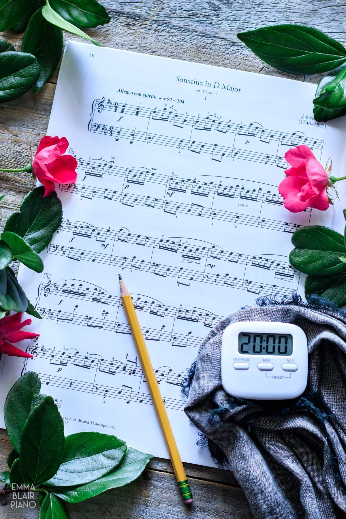 sonatina sheet music with a timer and pencil