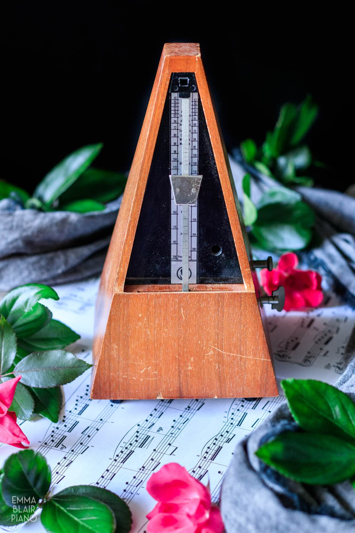 metronome and sheet music with roses