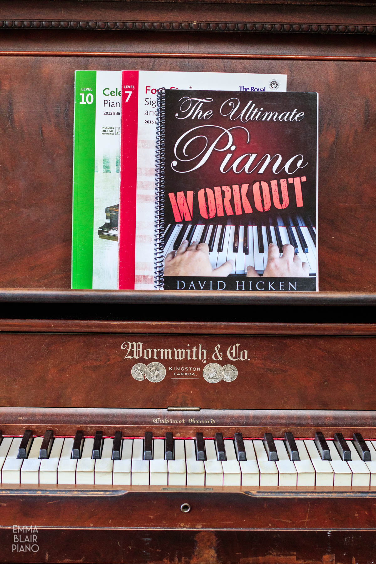 music books on the piano music stand