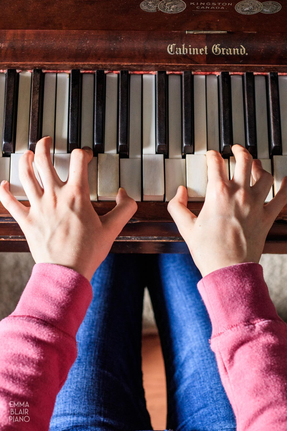 overhead view of a girl playing the piano