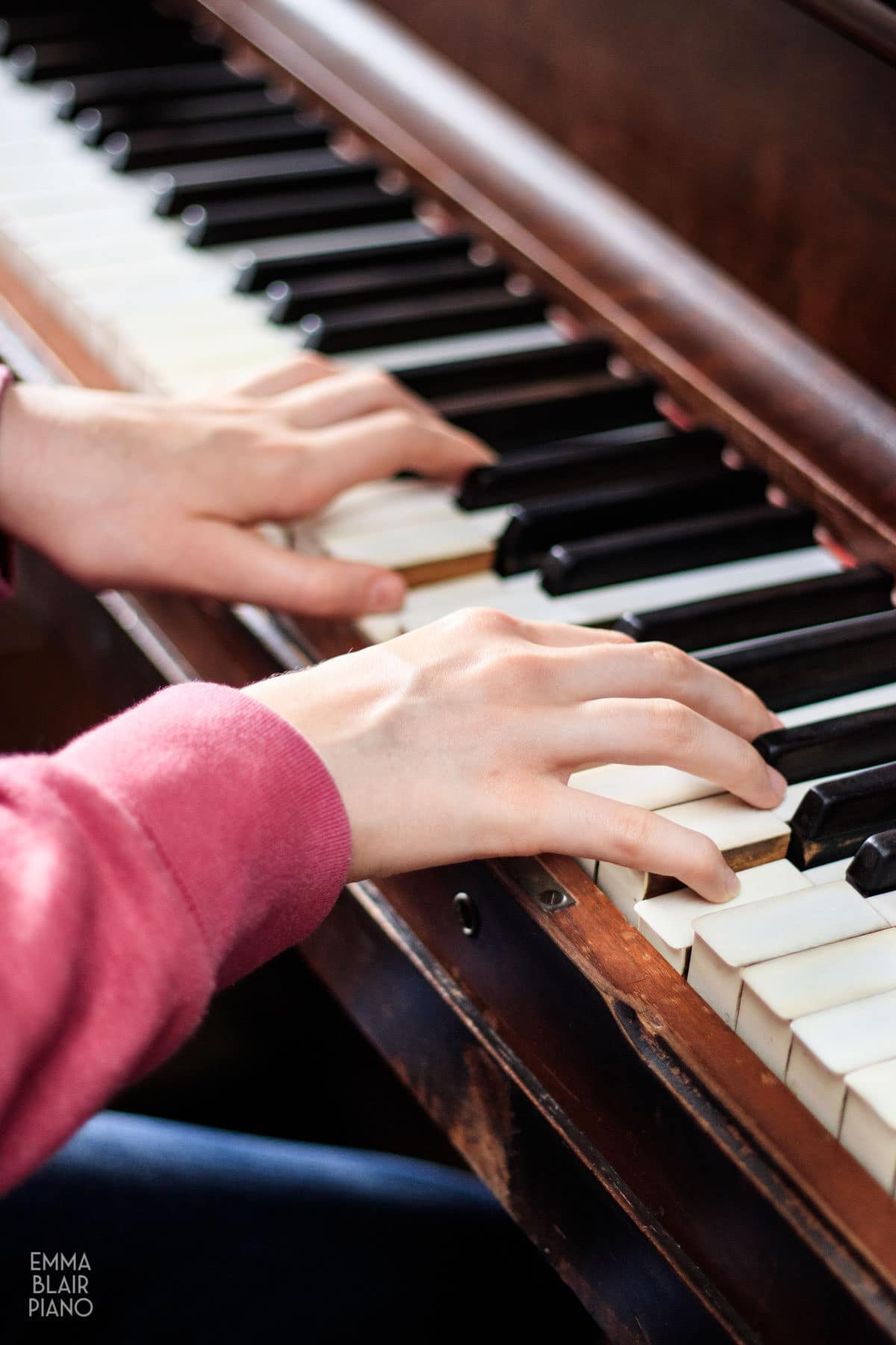 side view of a girl playing the piano