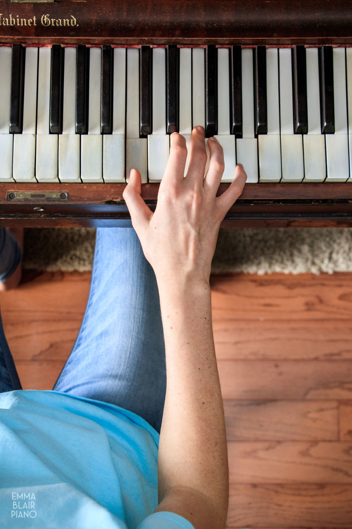 girl demonstrating correct arm and body position at the piano