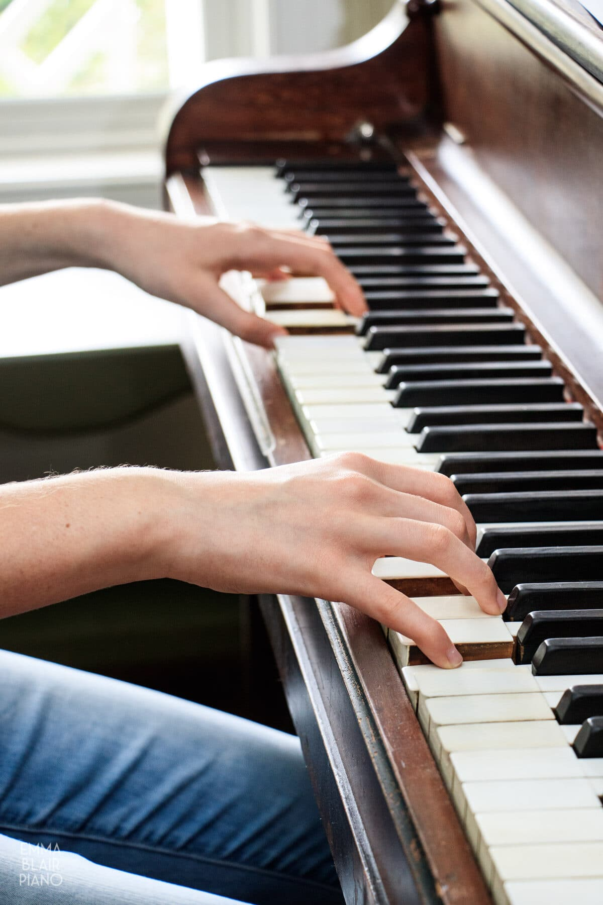 girl demonstrating correct hand and wrist alignment at the piano