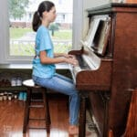 girl demonstrating correct posture at the piano