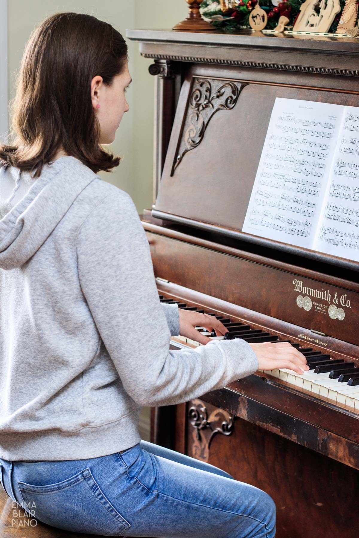 teenage girl practicing the piano