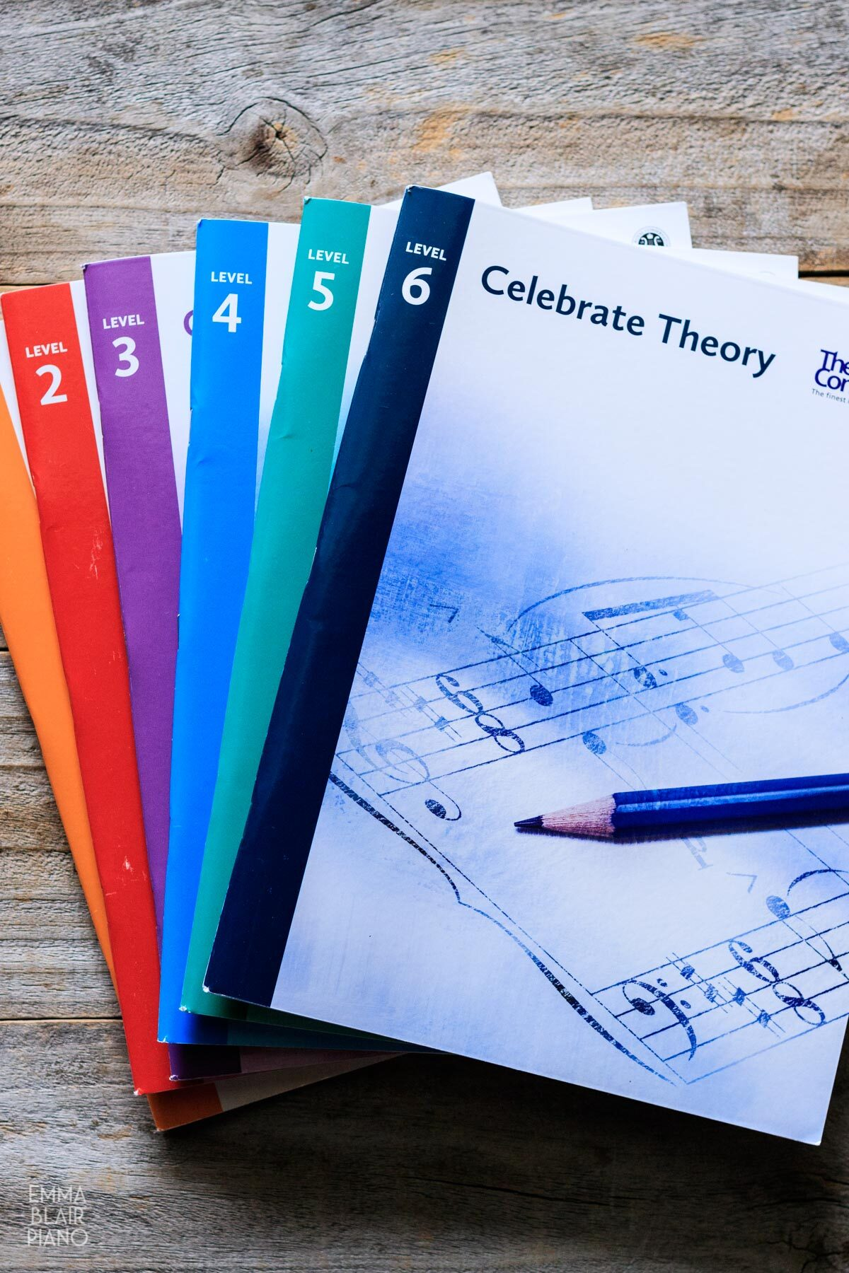 stack of music theory books from levels 1-6