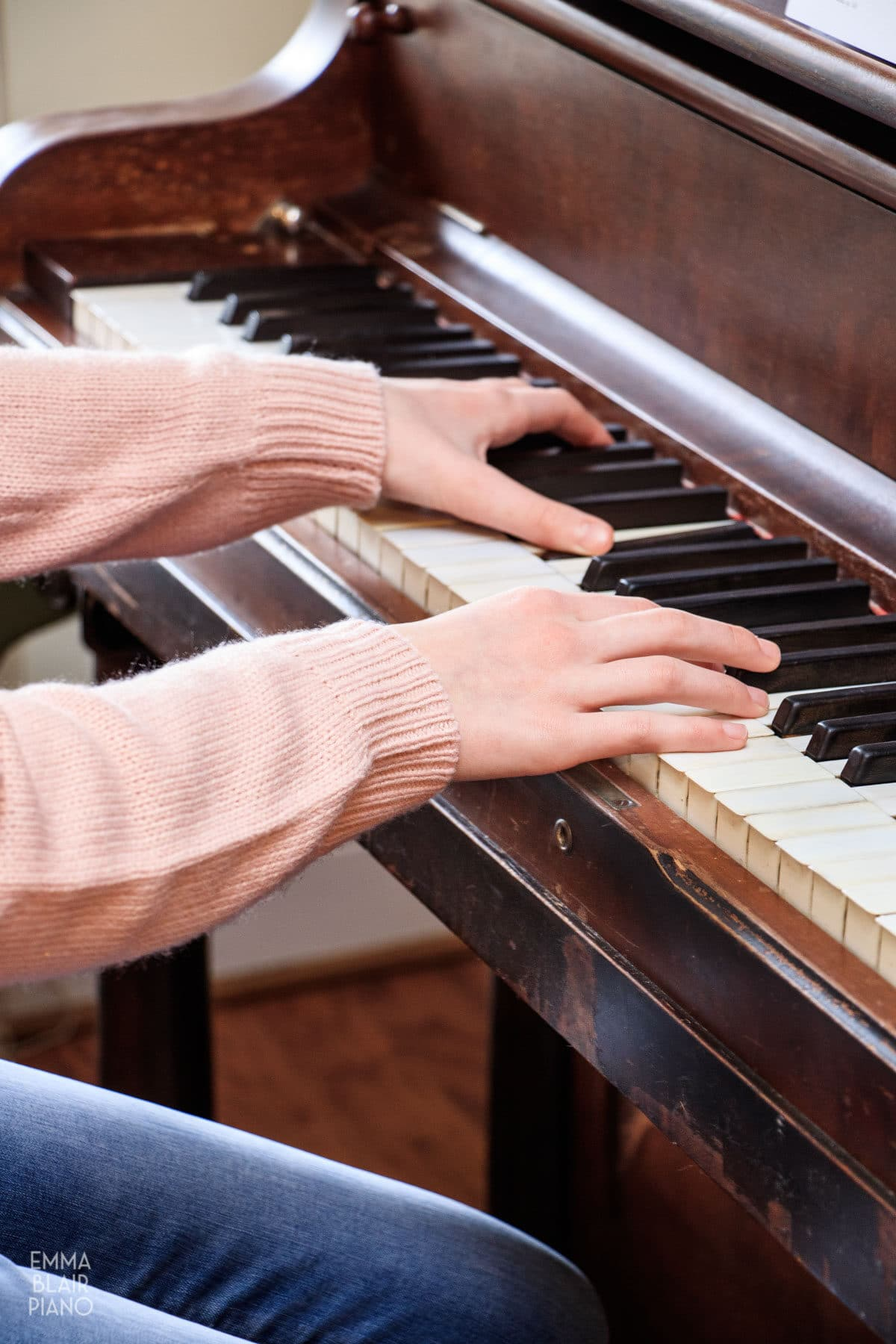 teenage girl playing the piano