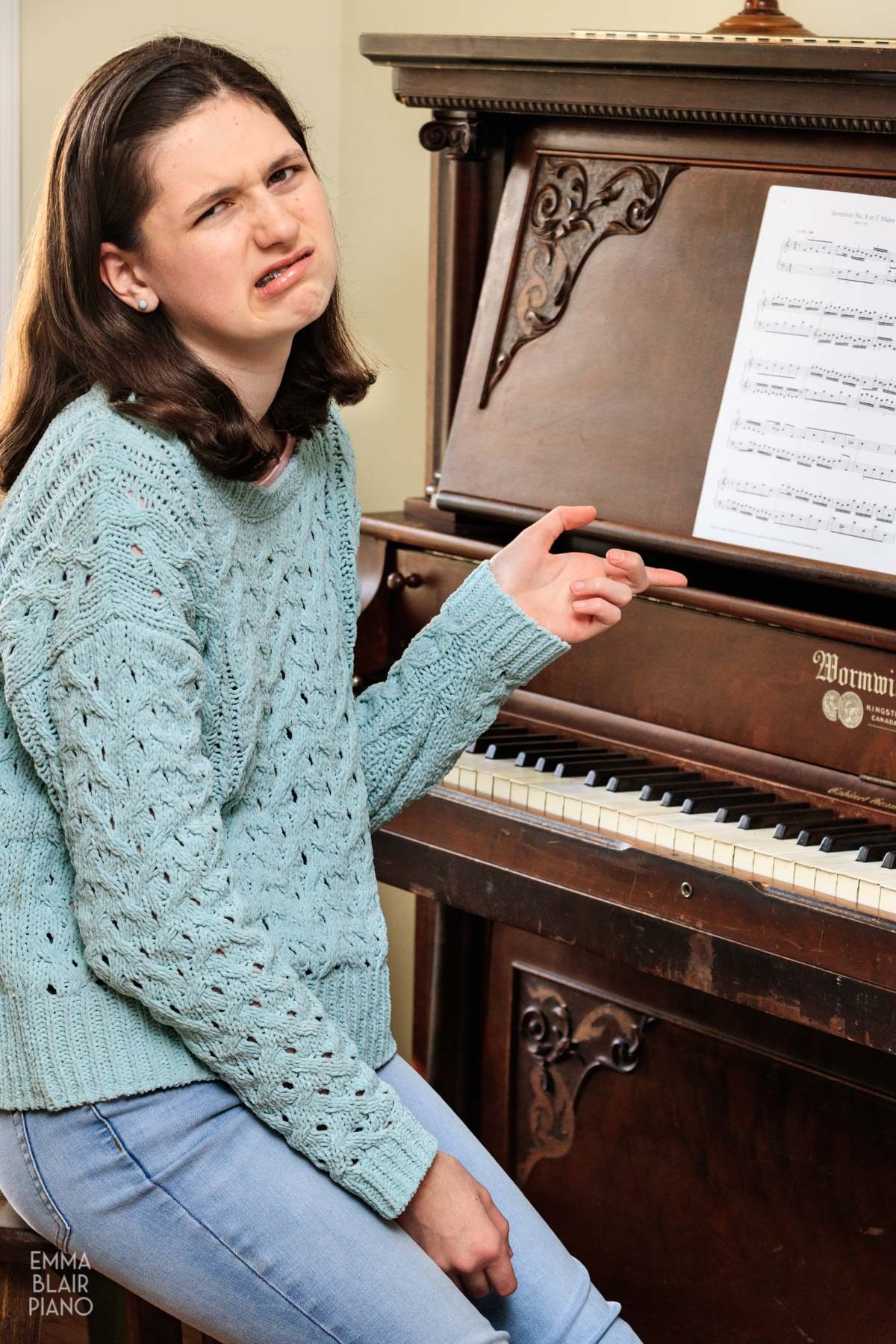 teenage girl frustrated with her piano music
