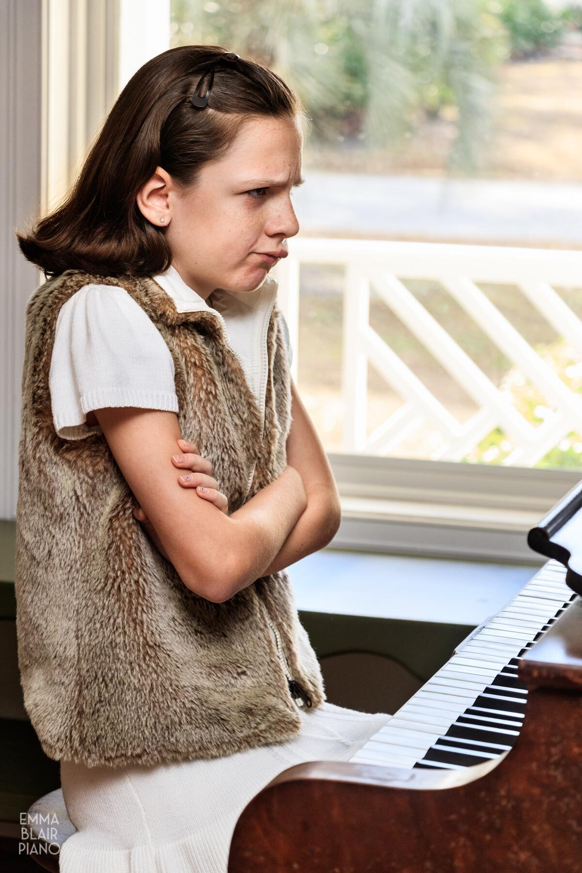 young girl frustrated with her piano music