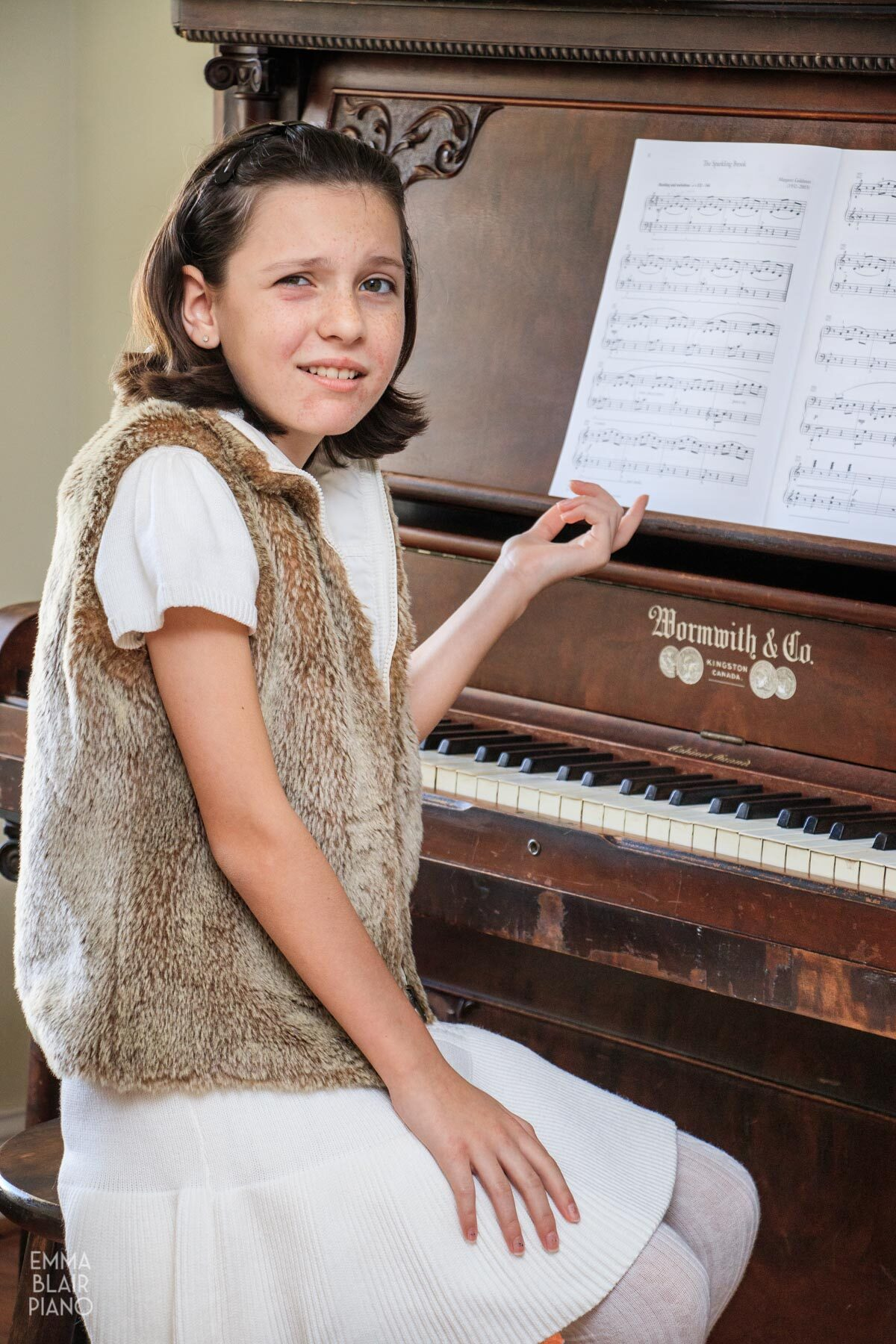 puzzled young girl sitting at the piano