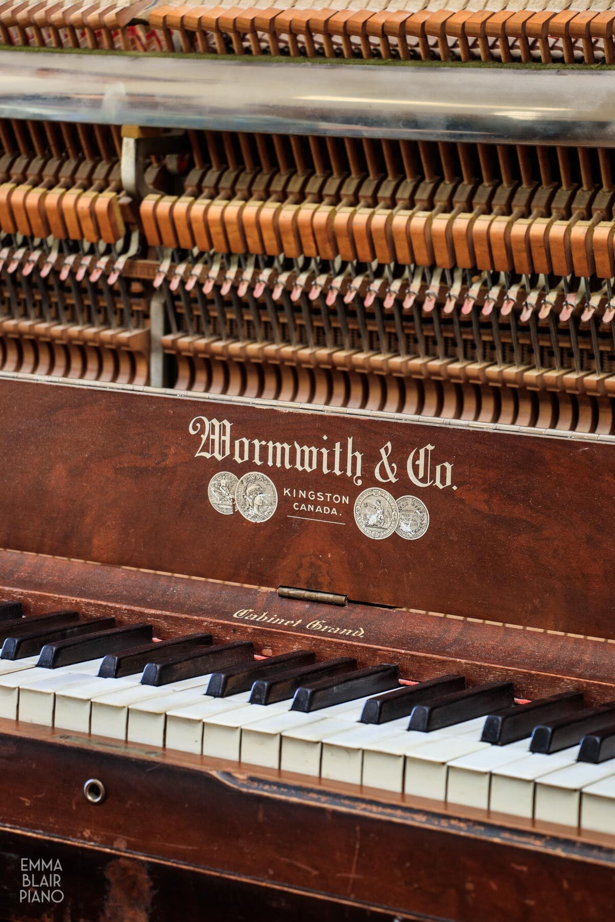 a side view of an upright grand piano action and keyboard