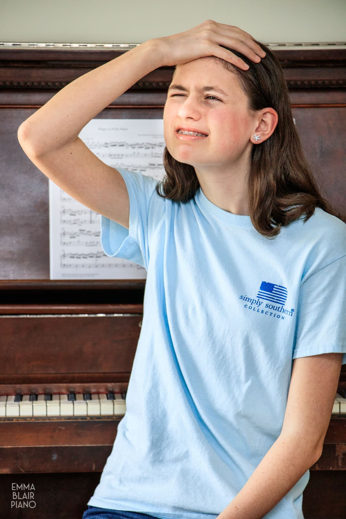 teenage girl feeling nervous about playing the piano
