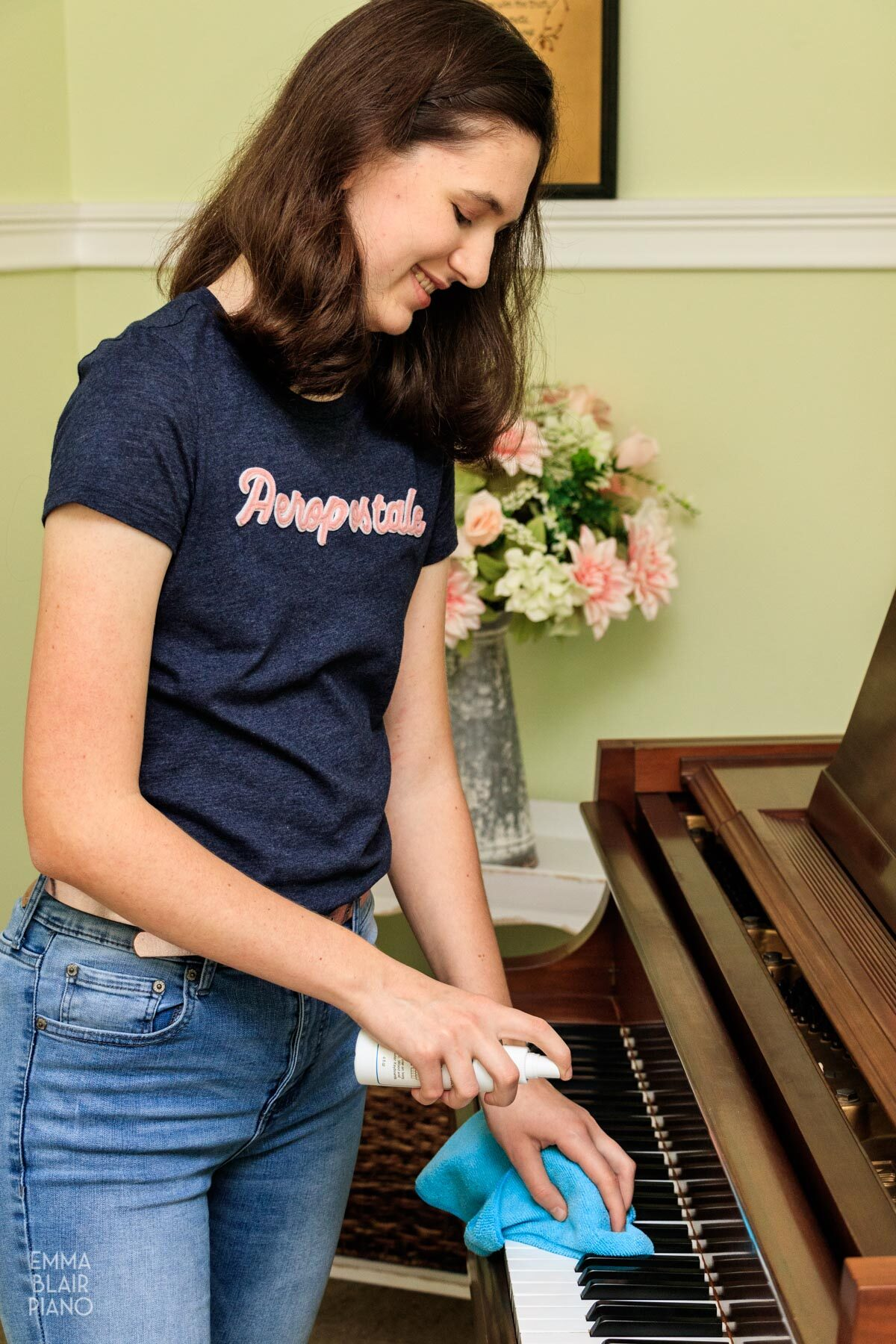 girl cleaning piano keys with Cory Key-Brite spray