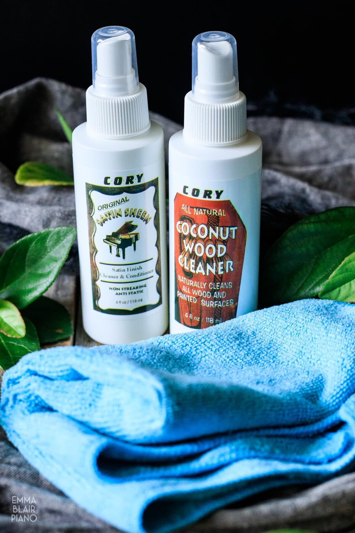 bottles of satin polish and wood cleaner with a microfiber cloth