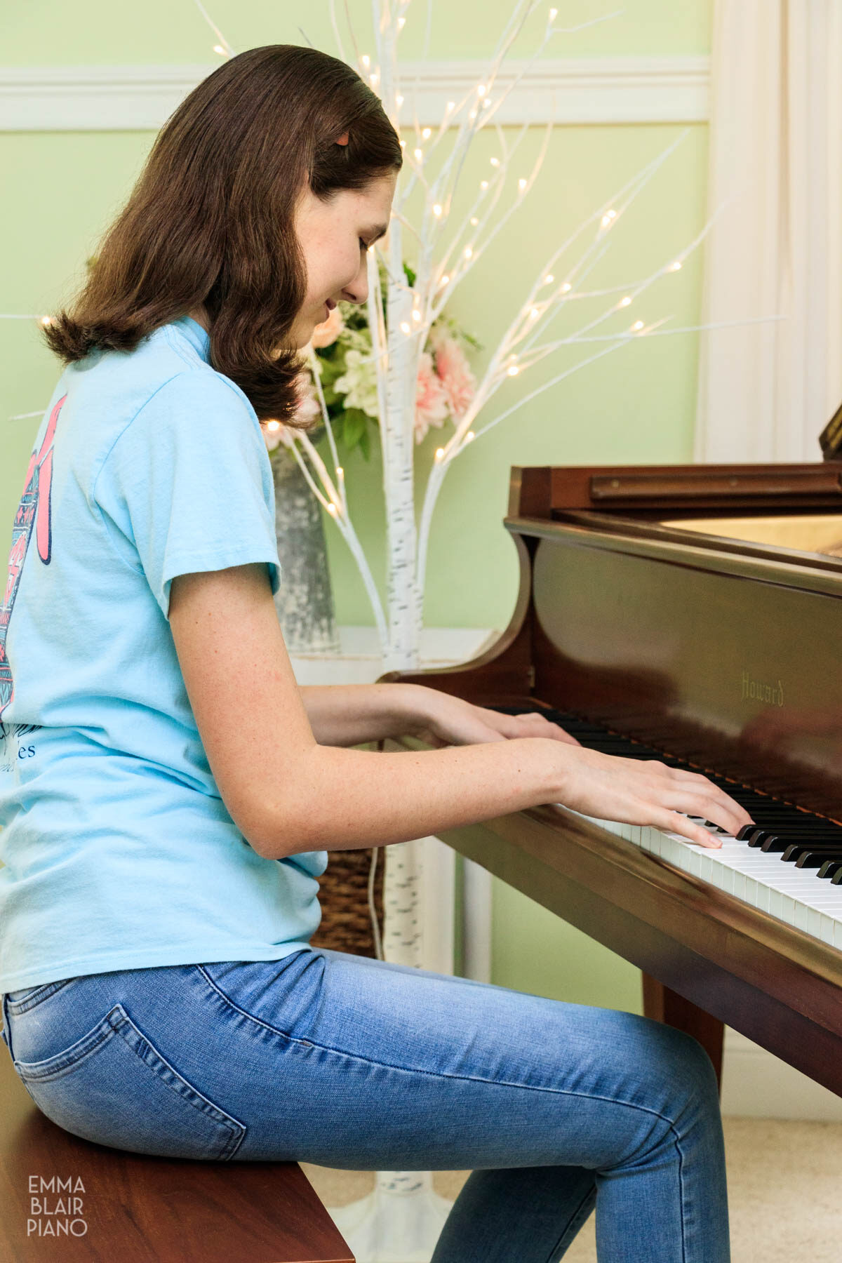 teenage girl playing a piano piece from memory